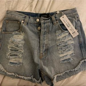 Mink Pink Jean shorts, new with tags. Size L